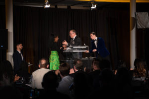 Young lady accepting award at a podium on stage