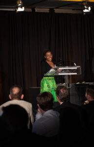 Young lady making speech at a podium on stage