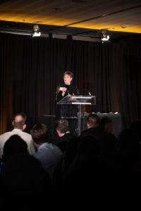 Kathy Ullyott making speech at podium on stage